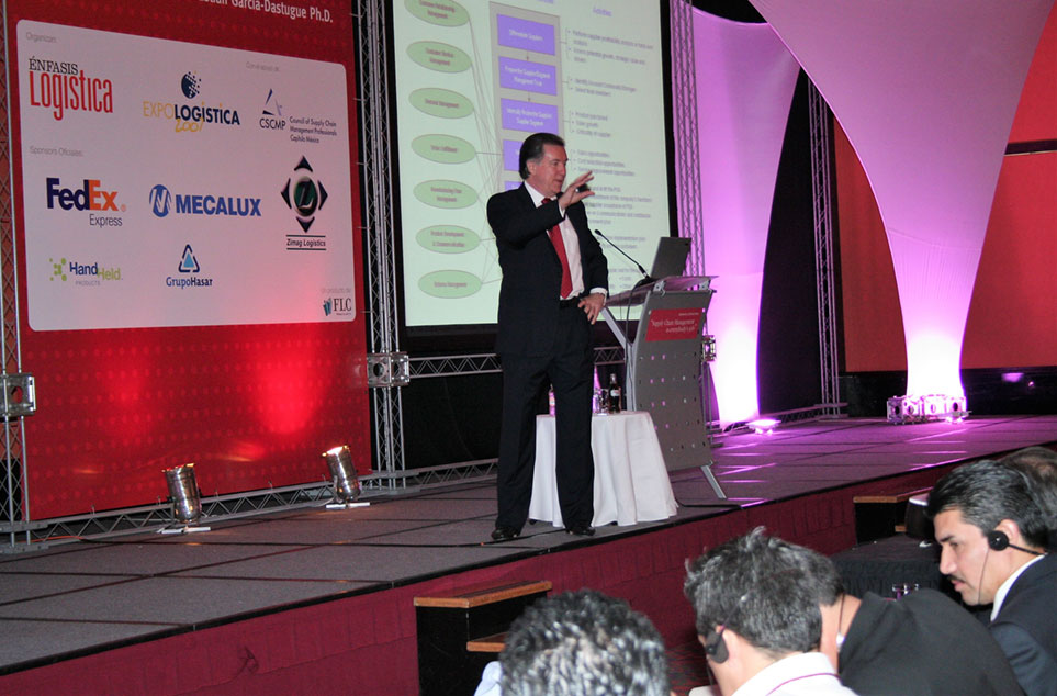 Dr. Douglas speaking at a Mexico conference